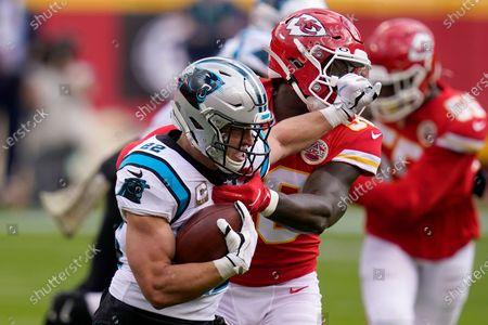 Carolina Panthers running back Christian McCaffrey, left, runs against Kansas City Chiefs linebacker Willie Gay Jr. during the first half of an NFL football game in Kansas City, Mo