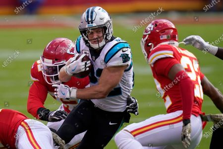 Carolina Panthers running back Christian McCaffrey, center, runs against the Kansas City Chiefs during the first half of an NFL football game in Kansas City, Mo