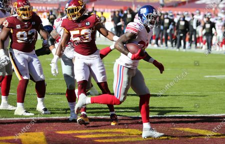 New York Giants running back Wayne Gallman (22) scores a touchdown during an NFL football game against the Washington Football Team, in Landover, Md