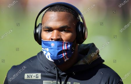 New York Giants nose tackle Dalvin Tomlinson (94) wears a FOCO mask before an NFL football game against the Washington Football Team, in Landover, Md