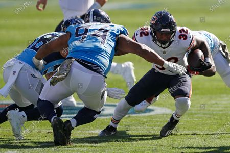 Stock Picture of Chicago Bears running back David Montgomery (32) carries the ball against Tennessee Titans defensive tackle Jack Crawford (94) in the first half of an NFL football game, in Nashville, Tenn