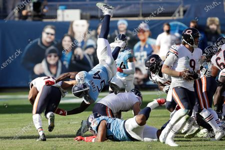 Stock Image of Tennessee Titans inside linebacker Rashaan Evans (54) tries to stop Chicago Bears running back David Montgomery, left, in the second half of an NFL football game, in Nashville, Tenn