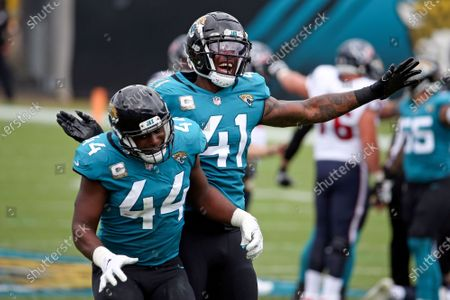 Jacksonville Jaguars linebacker Myles Jack (44) and linebacker Josh Allen (41) celebrate after the Jaguars recovered a Houston Texans fumble during the first half of an NFL football game, in Jacksonville, Fla