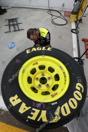 Pit crew member for driver Ryan Blaney preps tires prior to a NASCAR Cup Series auto race at Phoenix Raceway, in Avondale, Ariz