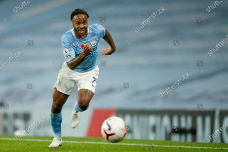 Manchester City's Raheem Sterling runs with the ball during the English Premier League soccer match between Manchester City and Liverpool at the Etihad stadium in Manchester, England