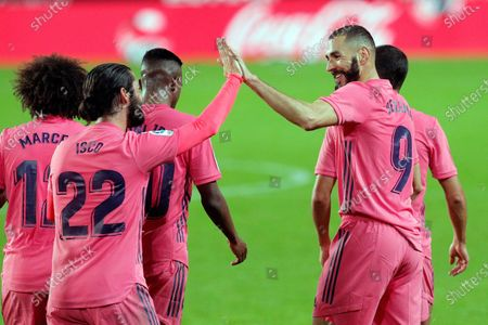Real Madrid's striker Karim Benzema (R) celebrates with teammates after scoring the 0-1 goal during the Spanish La Liga soccer match between Valencia CF and Real Madrid at Mestalla stadium in Valencia, eastern Spain, 08 November 2020.