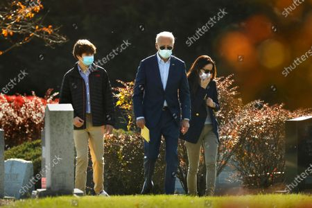 Stock Image of Wilmington, Pennsylvania-Nov. 8, 2020-President-elect Joe Biden, center, visits the grave of his son Beau Biden after attending church at St. Joseph on the Brandywine Roman Catholic Church in Wilmington, Delaware on Nov.8, 2020. Accompanying Biden is his grandson Hunter Biden, left, son of Beau Biden, and his daughter Ashley Biden, right, (wife of Beau Biden). (Carolyn Cole / Los Angeles Times)
