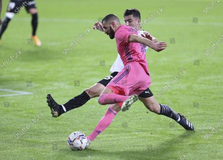 Real Madrid's Karim Benzema and Valencia's Hugo Guillamon fight for the ball during the Spanish La Liga soccer match between Valencia and Real Madrid at the Mestalla Stadium in Valencia, Spain