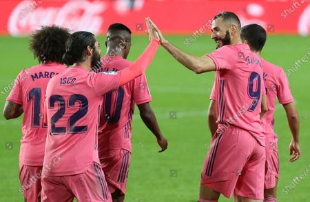 Real Madrid's Karim Benzema, center right, celebrates with teammates after scoring his side's first goal during the Spanish La Liga soccer match between Valencia and Real Madrid at the Mestalla Stadium in Valencia, Spain