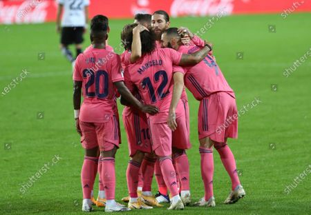 Stock Photo of Real Madrid's team players celebrate after Karim Benzema scores their side's first goal during the Spanish La Liga soccer match between Valencia and Real Madrid at the Mestalla Stadium in Valencia, Spain