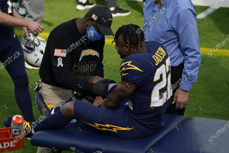 Los Angeles Chargers running back Justin Jackson after an injury during the first half of an NFL football game against the Las Vegas Raiders, in Inglewood, Calif