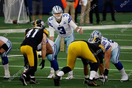 """Pittsburgh Steelers linebacker Robert Spillane (41) lines up as Dallas Cowboys quarterback Garrett Gilbert (3), wearing a """"Salute To Service"""" themed towel on his waist, signals at the line of scrimmage during the first half of an NFL football game in Arlington, Texas"""