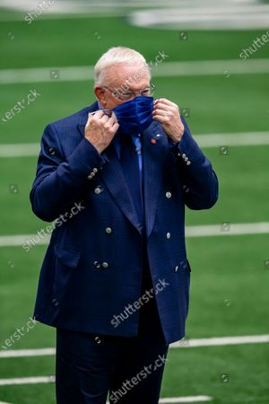 Dallas Cowboys owner Jerry Jones puts on a mask before an NFL football game against the Pittsburgh Steelers, in Arlington, Texas. Pittsburgh won 24-19