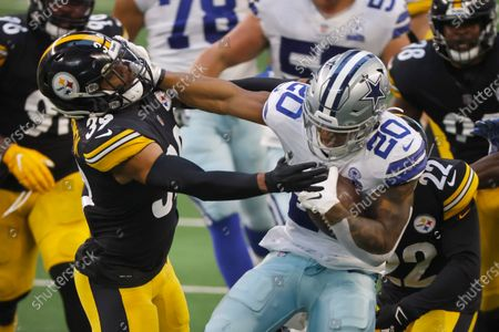 Dallas Cowboys running back Tony Pollard (20) stiff arms Pittsburgh Steelers safety Minkah Fitzpatrick (39) during an NFL football game in Arlington, Texas
