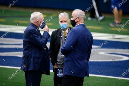 Dallas Cowboys chief operating officer/director of player personnel Stephen Jones, right, and owner Jerry Jones, left greet Pittsburgh Steelers team owner Art Rooney II, center, during team warmups before an NFL football game in Arlington, Texas