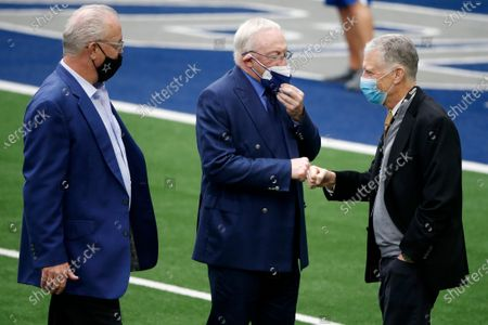 Dallas Cowboys chief operating officer/director of player personnel Stephen Jones, left, and owner Jerry Jones, center, greet Pittsburgh Steelers team owner Art Rooney II, right, during team warmups before an NFL football game in Arlington, Texas