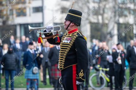 Stock Photo of The last post played by Sgt. Adam Desborough Trumpet Major of The Kings Troops at the Royal Artillery War memorial at Hyde Park Corner on Remembrance Sunday.