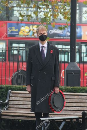 Stock Image of Stephen Timms, MP of East Ham at the War Memorial in East Ham in a scaled-down  Remembrance Day event. On the eleventh Hour, the gathered observed a minute's silence to remember the fallen. In this year's Remembrance Day, the crowds were few and had to observe social distancing due to the prevailing covid19 pandemic.