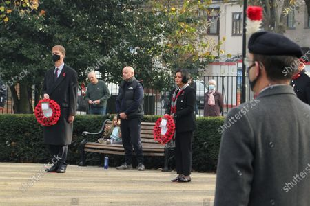 Stock Picture of Stephen Timms, MP of East Ham with Mayor of Newham, Rokhsana Fiaz hold wreaths of poppies at the War Memorial in East Ham in a scaled-down Remembrance Day event. On the eleventh Hour, the gathered observed a minute's silence to remember the fallen. In this year's Remembrance Day, the crowds were few and had to observe social distancing due to the prevailing covid19 pandemic.