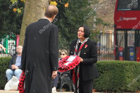 Stephen Timms, MP of East Ham with Mayor of Newham, Rokhsana Fiaz at the War Memorial in East Ham in a scaled-down  Remembrance Day event. On the eleventh Hour, the gathered observed a minute's silence to remember the fallen. In this year's Remembrance Day, the crowds were few and had to observe social distancing due to the prevailing covid19 pandemic.