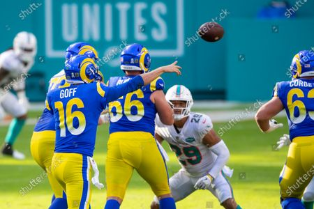 Los Angeles Rams quarterback Jared Goff (16) throws the ball as Los Angeles Rams offensive lineman David Edwards (73) and Los Angeles Rams center Austin Blythe (66) block along with Miami Dolphins safety Brandon Jones (29) during an NFL football game, in Miami Gardens, Fla