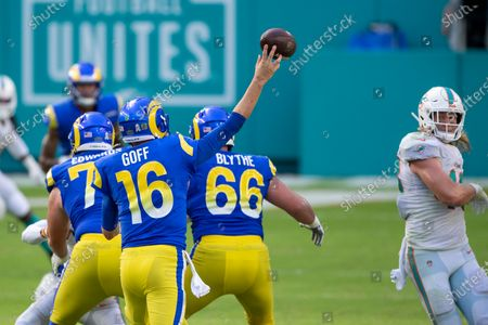 Stock Image of Los Angeles Rams quarterback Jared Goff (16) throws the ball as Los Angeles Rams offensive lineman David Edwards (73) and Los Angeles Rams center Austin Blythe (66) block along with Miami Dolphins linebacker Andrew Van Ginkel (43) during an NFL football game, in Miami Gardens, Fla