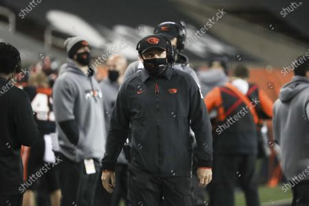 Oregon State head coach Jonathan Smith walks up the sideline during an NCAA college football game against Washington State in Corvallis, Ore., . Washington State won 38-28
