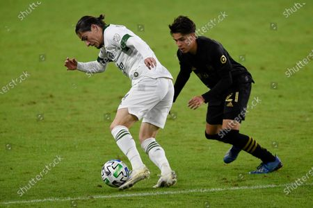 Portland Timbers defender Jorge Villafaña, left, moves the ball past Los Angeles FC forward Christian Torres during the second half of an MLS soccer match in Los Angeles