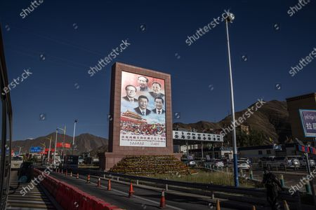 A monument showing Chinese leaders, clockwise from top, Mao Zedong, Deng Xiaoping, Hu Jintao, current Chinese President Xi Jinping, and Jiang Zemin, in Lhasa, Tibet Autonomous Region, China, 14 October 2020. The picture was taken during a media tour to Tibet organized by the Chinese government that focused on China's poverty alleviation program for the region.  The natural beauty of Tibet, the thousand-year-old Himalayan roof of the world, still dazzles the few visitors who are allowed in. But today, in many places, bulldozers, highways, and modern apartment towers have replaced the grazing yaks and the chanting Buddhist monks. According to the Beijing government, extreme poverty - an endemic problem in Tibet, where pastoralism has traditionally been the sole source of income for most people - has been eradicated. In recent years, the central government has made colossal investments in Tibet, both in infrastructure and poverty reduction programs. Since 2016, Beijing has invested 74.85 billion yuan (USD 11.1 billion) in projects to improve access to health, education, clean water, housing, or infrastructure in the region's poorest areas.