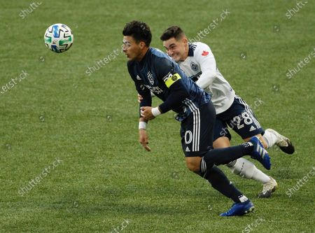 Los Angeles Galaxy forward Cristian Pavon, left, controls the ball as Vancouver Whitecaps defender Jake Nerwinski defends during the first half of an MLS soccer match in Portland, Ore
