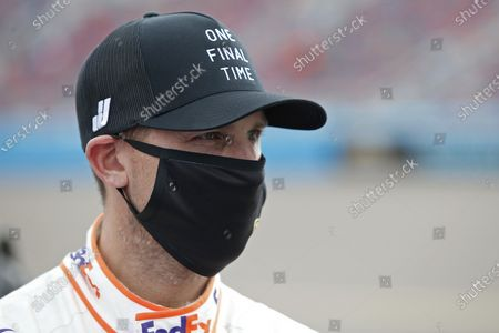 Denny Hamlin looks on from pit road prior to the NASCAR Cup Series auto race at Phoenix Raceway, in Avondale, Ariz