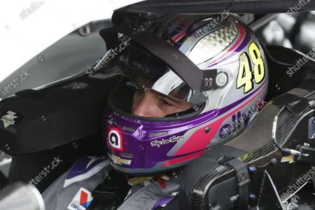 Jimmie Johnson inside his race car prior to the NASCAR Cup Series auto race at Phoenix Raceway, in Avondale, Ariz