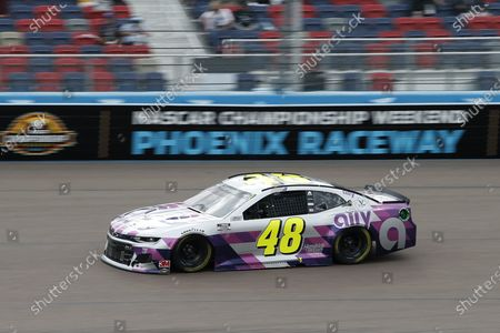 Jimmie Johnson (48) races through Turn 4 during the NASCAR Cup Series auto race at Phoenix Raceway, in Avondale, Ariz