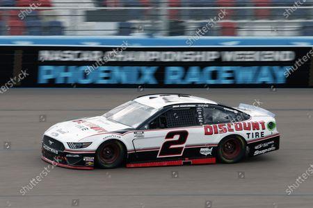 Brad Keselowski (2) races through Turn 4 during the NASCAR Cup Series auto race at Phoenix Raceway, in Avondale, Ariz