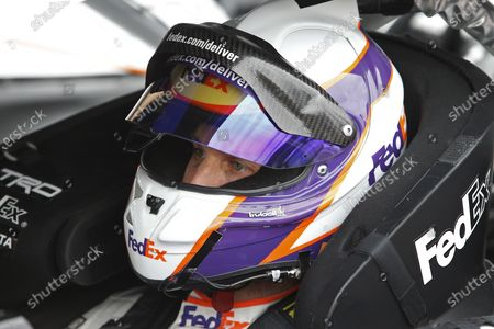 Stock Picture of Denny Hamlin looks on from his race car prior to the NASCAR Cup Series auto race at Phoenix Raceway, in Avondale, Ariz