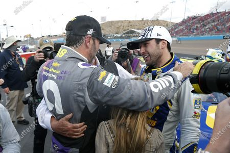 Stock Photo of Jimmie Johnson, left, congratulates Chase Elliott following Elliott's season championship victory in the NASCAR Cup Series auto race at Phoenix Raceway, in Avondale, Ariz