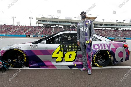 Jimmie Johnson stands with his race car on pit road prior to the NASCAR Cup Series auto race at Phoenix Raceway, in Avondale, Ariz