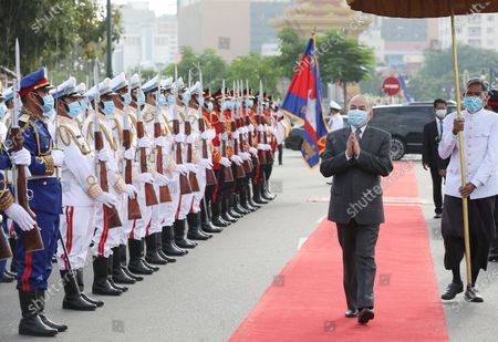 Cambodian King Norodom Sihamoni (C) walks past a guard of honor during a ceremony at the Independence Monument in Phnom Penh, Cambodia, 09 November 2?020. Cambodia marked its 67th anniversary of independence from France on 09 November 2020.