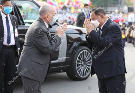 Cambodian King Norodom Sihamoni (C) greets President of the Senate Say Chhum (R) during a ceremony at the Independence Monument in Phnom Penh, Cambodia, 09 November 2020. Cambodia marked its 67th anniversary of independence from France on 09 November 2020.