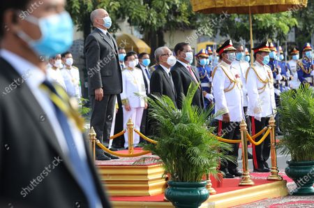 Cambodian King Norodom Sihamoni (2-L) listens to the National anthem during a ceremony at the Independence Monument in Phnom Penh, Cambodia, 09 November 2020. Cambodia marked its 67th anniversary of independence from France on 09 November 2020.