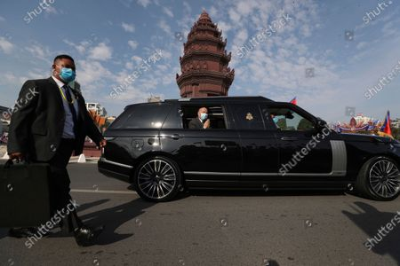 Stock Picture of Cambodia's King Norodom Sihamoni, center, greets from a vehicle to his government civil servants after he lit the victory fire during the country's 67th Independence Day celebration, in Phnom Penh, Cambodia