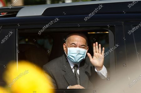 Stock Image of Cambodia's King Norodom Sihamoni waves from a vehicle to his government civil servants after he lit the victory fire during the country's 67th Independence Day celebration, in Phnom Penh, Cambodia