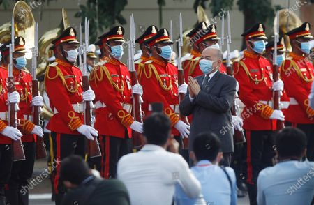 Cambodia's King Norodom Sihamoni, center, reviews the honorary troop during the country's 67th Independence Day celebration, in Phnom Penh, Cambodia