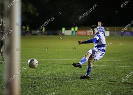 James Roberts of Oxford City have his penalty kick saved