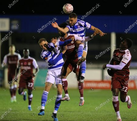 Stock Picture of Ricky Korboa of Northampton Town is out jumped to the ball by Luis Fernandez of Oxford City
