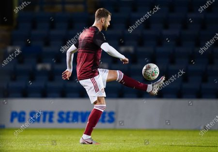 Stock Picture of Calum Chambers of Arsenal U21 warms up before kick-off