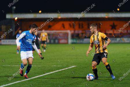 Andrew Dallas of Cambridge United (9) runs at Ronnie Edwards of Peterborough United (2)