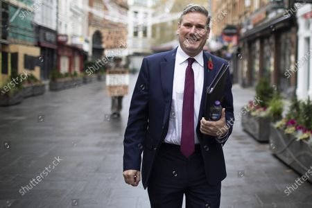 Labour Party Leader Sir Keir Starmer departs LBC Studios with Labour Party Director of Communications Ben Nunn(unseen) after appearing on Nick Ferrari at Breakfast.