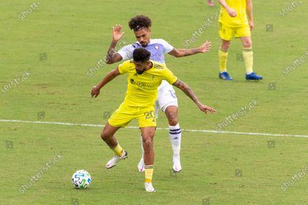 Midfielder Junior Urso (#11 Orlando City) and Midfielder Anibal Godoy (#20 Nashville SC) battle