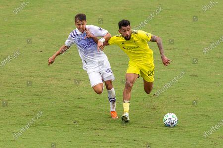Midfielder Jordan Bender (#33 Orlando City) and Midfielder Anibal Godoy (#20 Nashville SC) battle for the ball